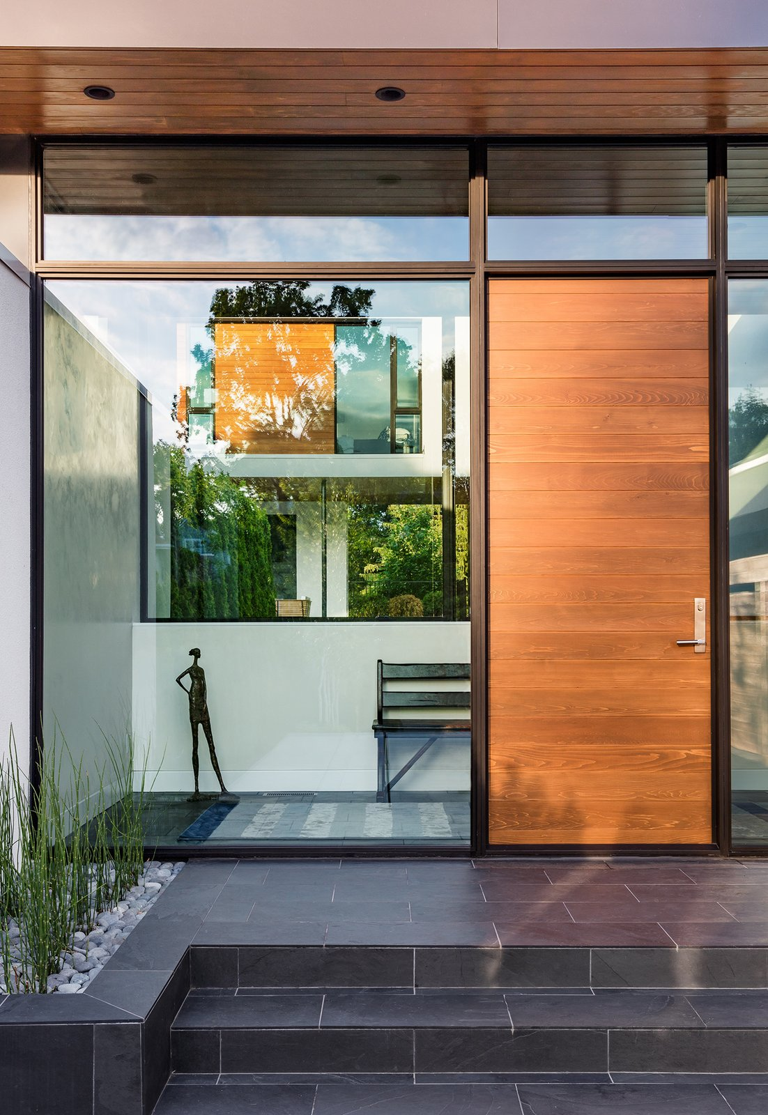 Tagged: Exterior, Swing Door Type, Metal, Picture Window Type, Outdoor, Front Yard, Tile Patio, Porch, Deck, and Raised Planters.  Calhoun Pavilions Residence by Peterssen/Keller Architecture