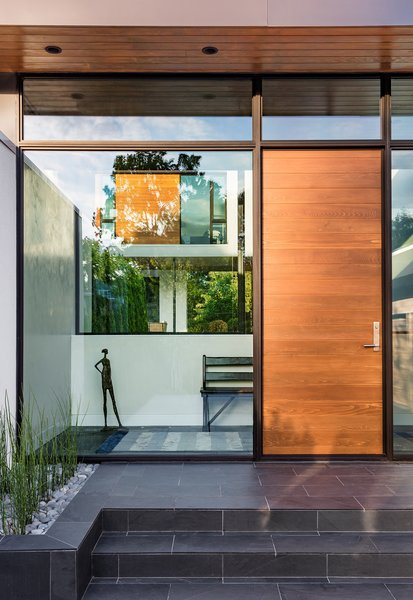 Modern home with exterior, swing door type, metal, picture window type, outdoor, front yard, tile patio, porch, deck, and raised planters. Photo 2 of Calhoun Pavilions Residence