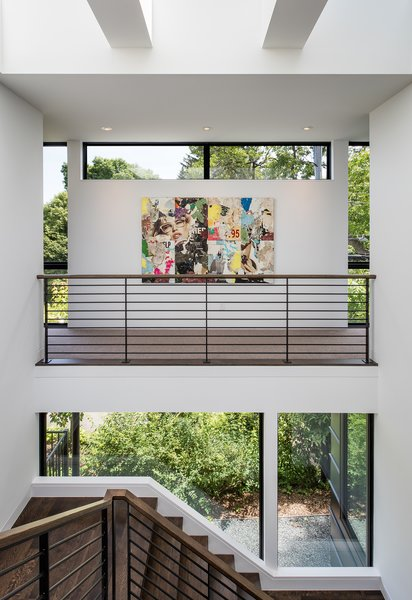 Modern home with metal railing, wood tread, windows, picture window type, awning window type, casement window type, and metal. Photo 12 of Calhoun Pavilions Residence