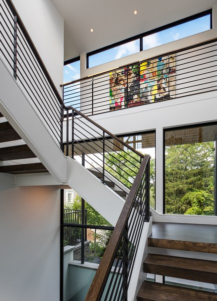 Modern home with wood tread, metal railing, windows, awning window type, picture window type, and metal. Photo 14 of Calhoun Pavilions Residence
