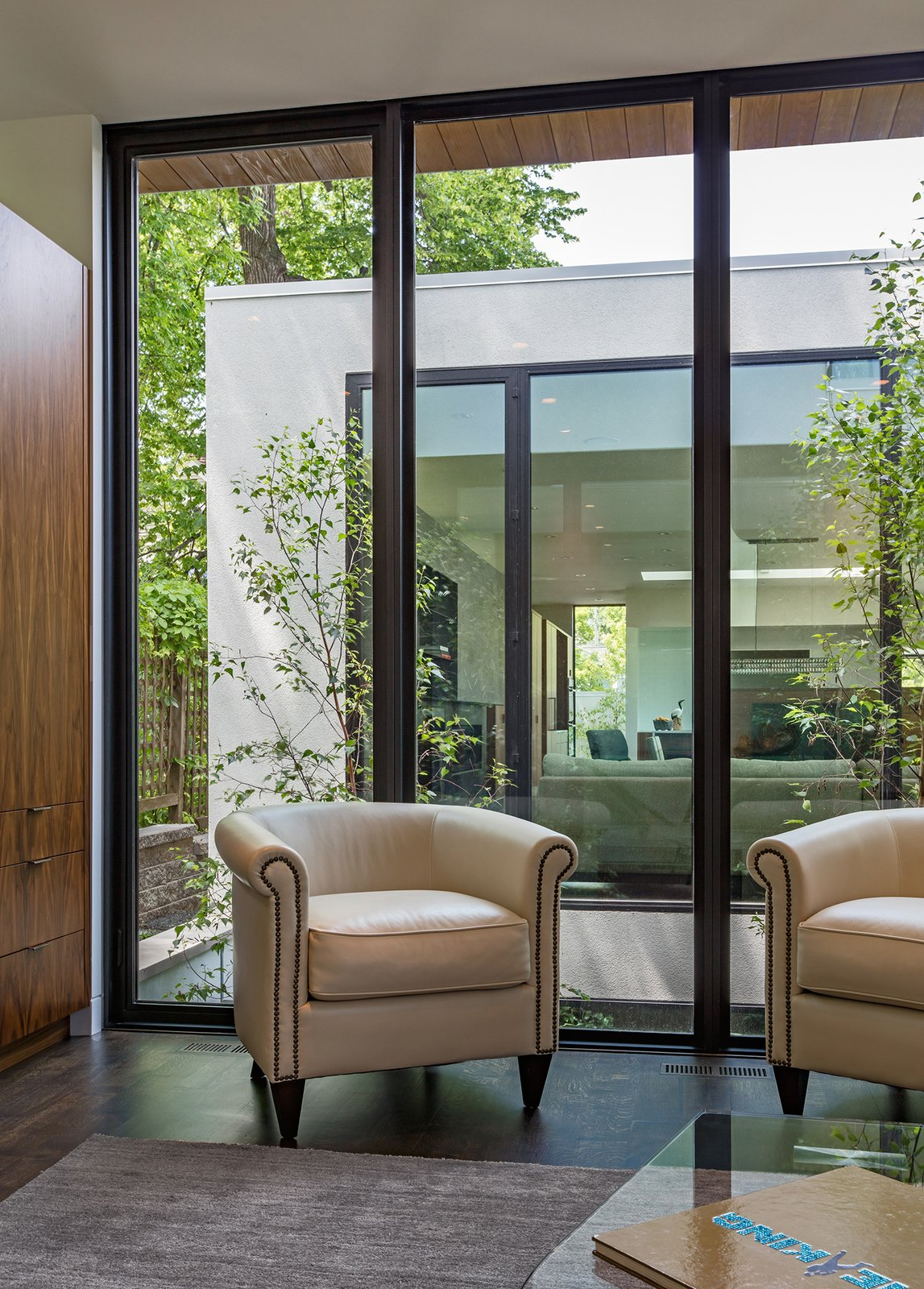 Tagged: Trees, Garden, Picture Window Type, Casement Window Type, Metal, Office, Den, Sun Room, Storage, Chair, and Dark Hardwood Floor.  Calhoun Pavilions Residence by Peterssen/Keller Architecture