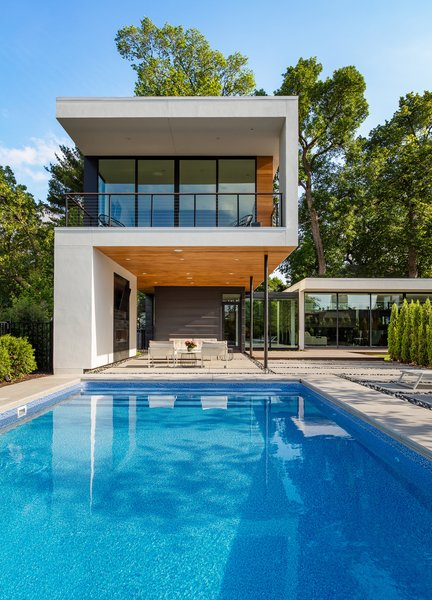 Modern home with outdoor, swimming pool, prefab container pool, concrete patio, porch, deck, back yard, lap pool, wood patio, porch, deck, stone patio, porch, deck, pavers patio, porch, deck, and gardens. Photo 4 of Calhoun Pavilions Residence