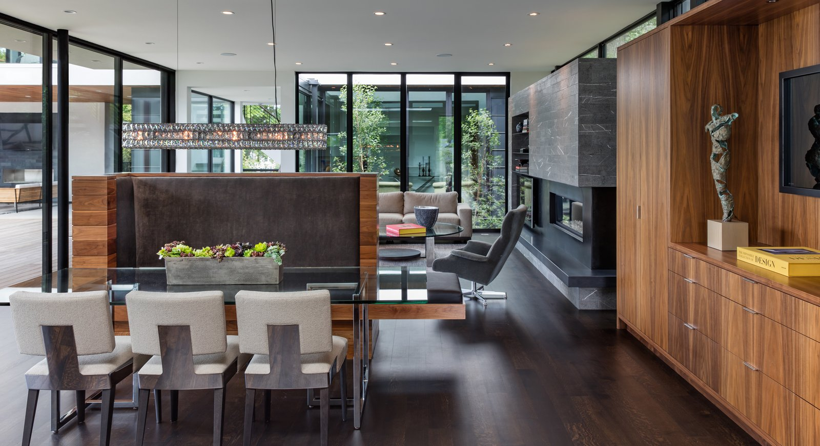 Tagged: Bench, Table, Chair, Shelves, Storage, Ceiling Lighting, Pendant Lighting, Accent Lighting, Sofa, Ribbon Fireplace, Dark Hardwood Floor, Gas Burning Fireplace, Outdoor, Corner Fireplace, and Garden.  Calhoun Pavilions Residence by Peterssen/Keller Architecture