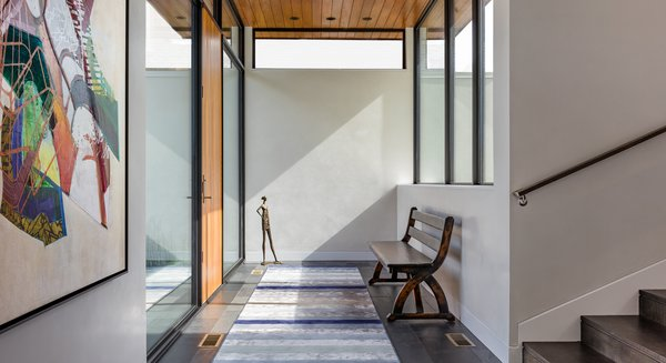 Modern home with ceramic tile floor, exterior, swing door type, windows, picture window type, and metal. Photo 7 of Calhoun Pavilions Residence