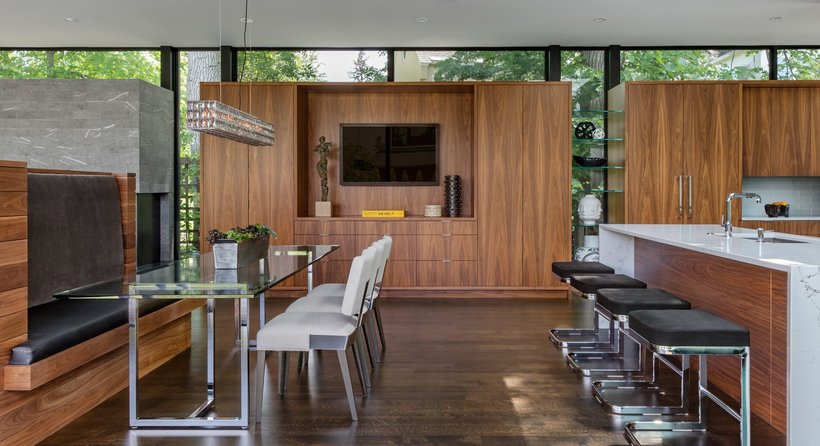 Tagged: Chair, Table, Bench, Storage, Accent Lighting, Pendant Lighting, Stools, Bar, Dark Hardwood Floor, Engineered Quartz Counter, Dining Room, Drop In Sink, and Ceiling Lighting.  Calhoun Pavilions Residence by Peterssen/Keller Architecture