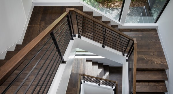 Modern home with staircase, wood tread, and metal railing. Photo 13 of Calhoun Pavilions Residence