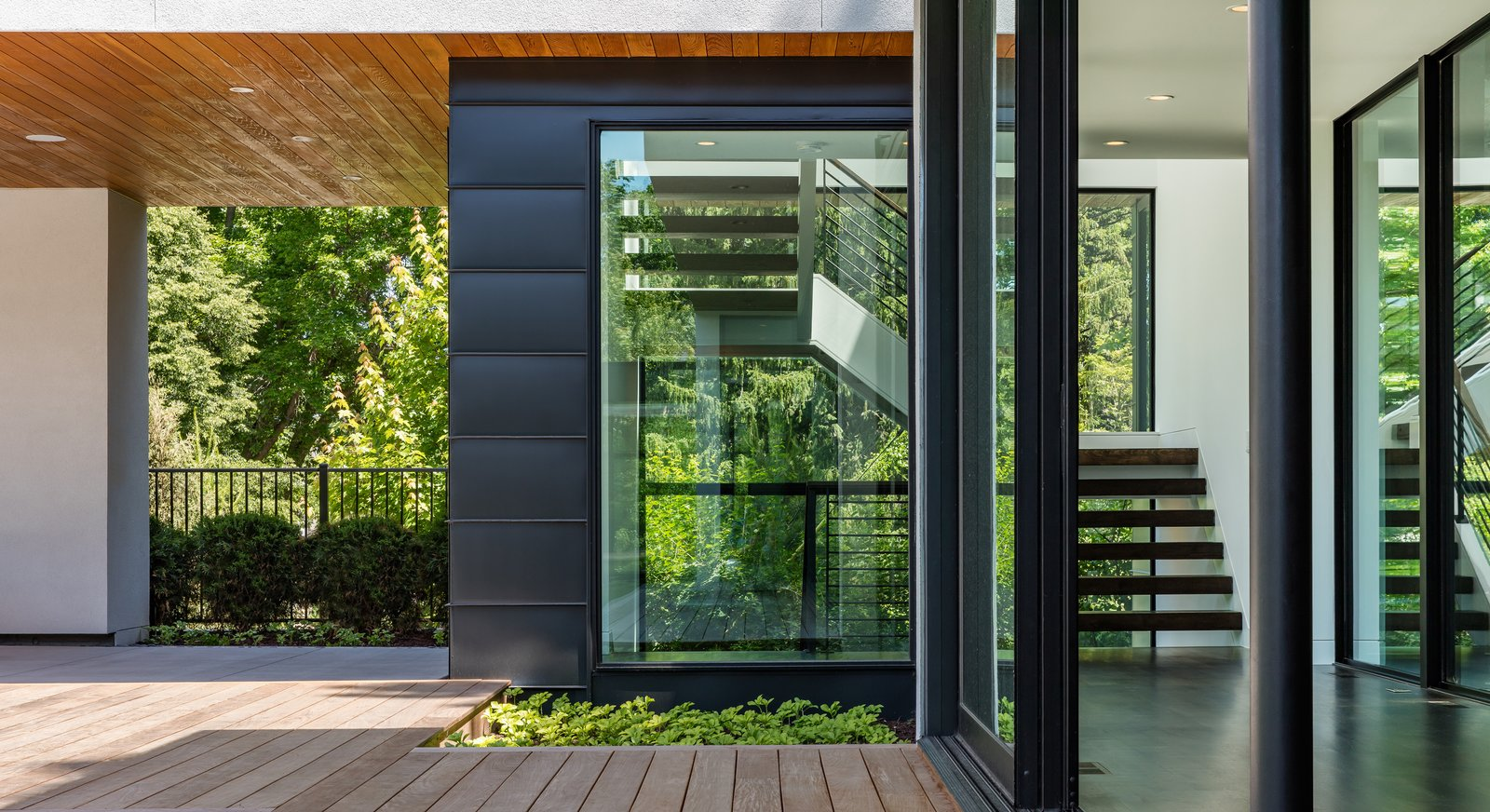 Tagged: Side Yard, Gardens, Walkways, Metal Patio, Porch, Deck, Garden, Wood Patio, Porch, Deck, Metal, Sliding Door Type, Exterior, Windows, and Picture Window Type.  Calhoun Pavilions Residence by Peterssen/Keller Architecture