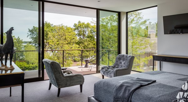 Modern home with bedroom, bed, and chair. Photo 17 of Calhoun Pavilions Residence