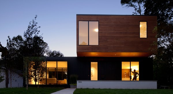 Modern home with outdoor, front yard, wood patio, porch, deck, trees, and metal patio, porch, deck. Photo  of Sheridan Residence
