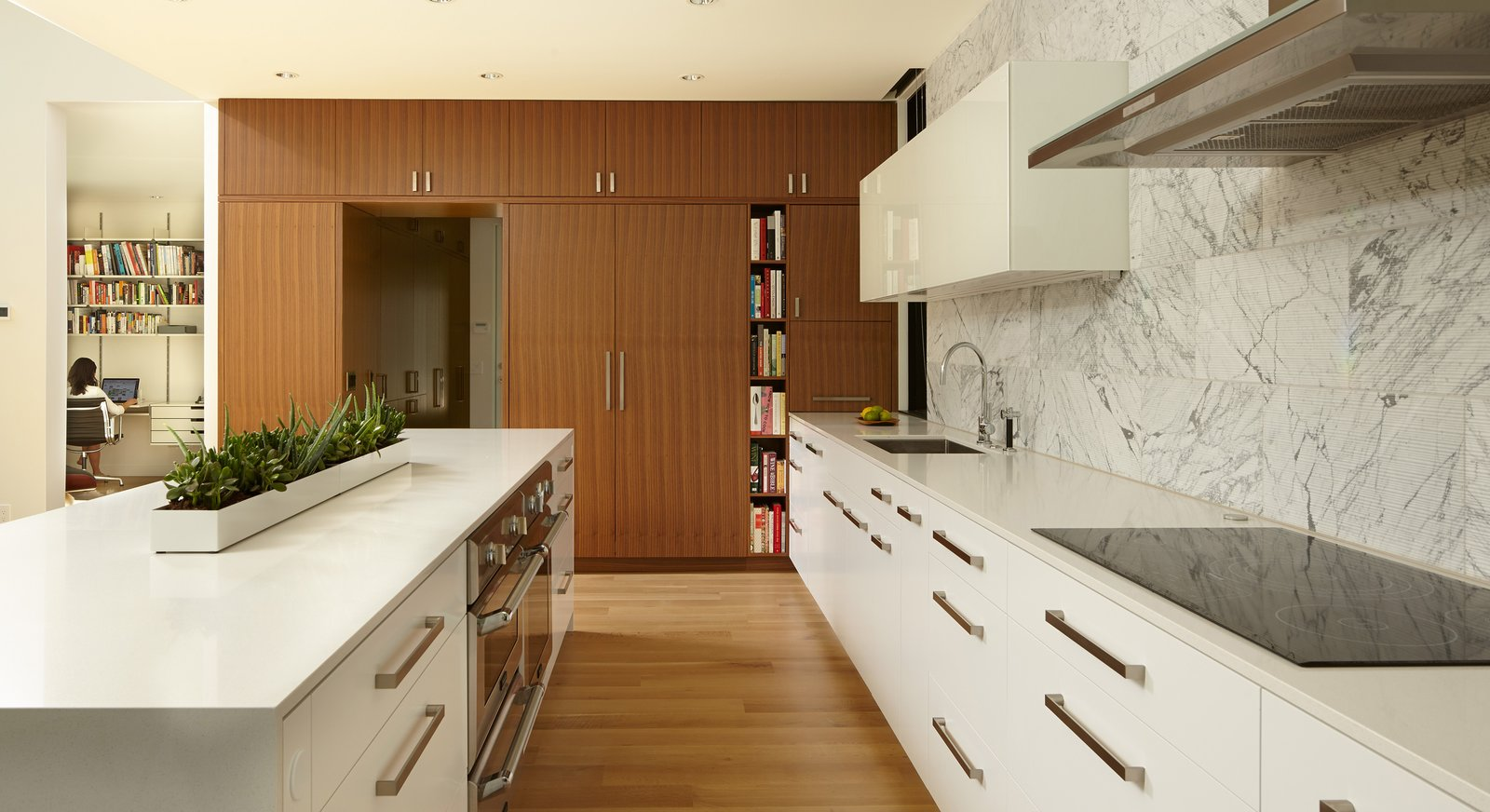 Tagged: Kitchen, White Cabinet, Light Hardwood Floor, Engineered Quartz Counter, Wood Cabinet, Ceiling Lighting, Stone Tile Backsplashe, Range Hood, Wall Oven, Refrigerator, Cooktops, and Drop In Sink.  Sheridan Residence by Peterssen/Keller Architecture