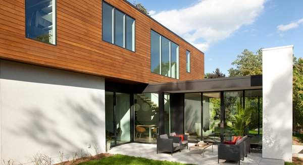 Modern home with outdoor, back yard, wood patio, porch, deck, metal patio, porch, deck, and pavers patio, porch, deck. Photo 5 of Sheridan Residence