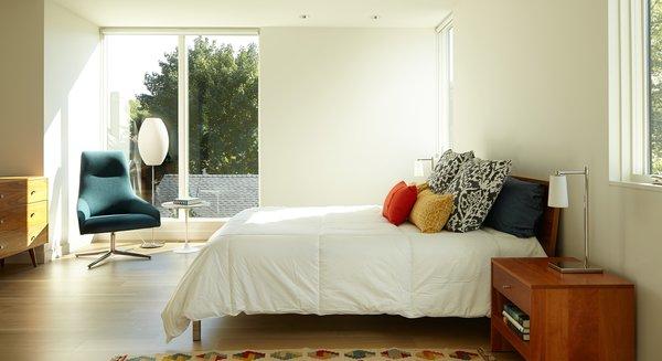Modern home with bedroom, bed, accent lighting, table lighting, light hardwood floor, and floor lighting. Photo 16 of Sheridan Residence