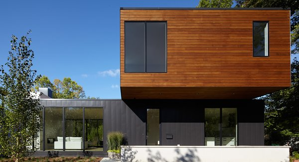 Modern home with outdoor, front yard, wood patio, porch, deck, and metal patio, porch, deck. Photo 2 of Sheridan Residence