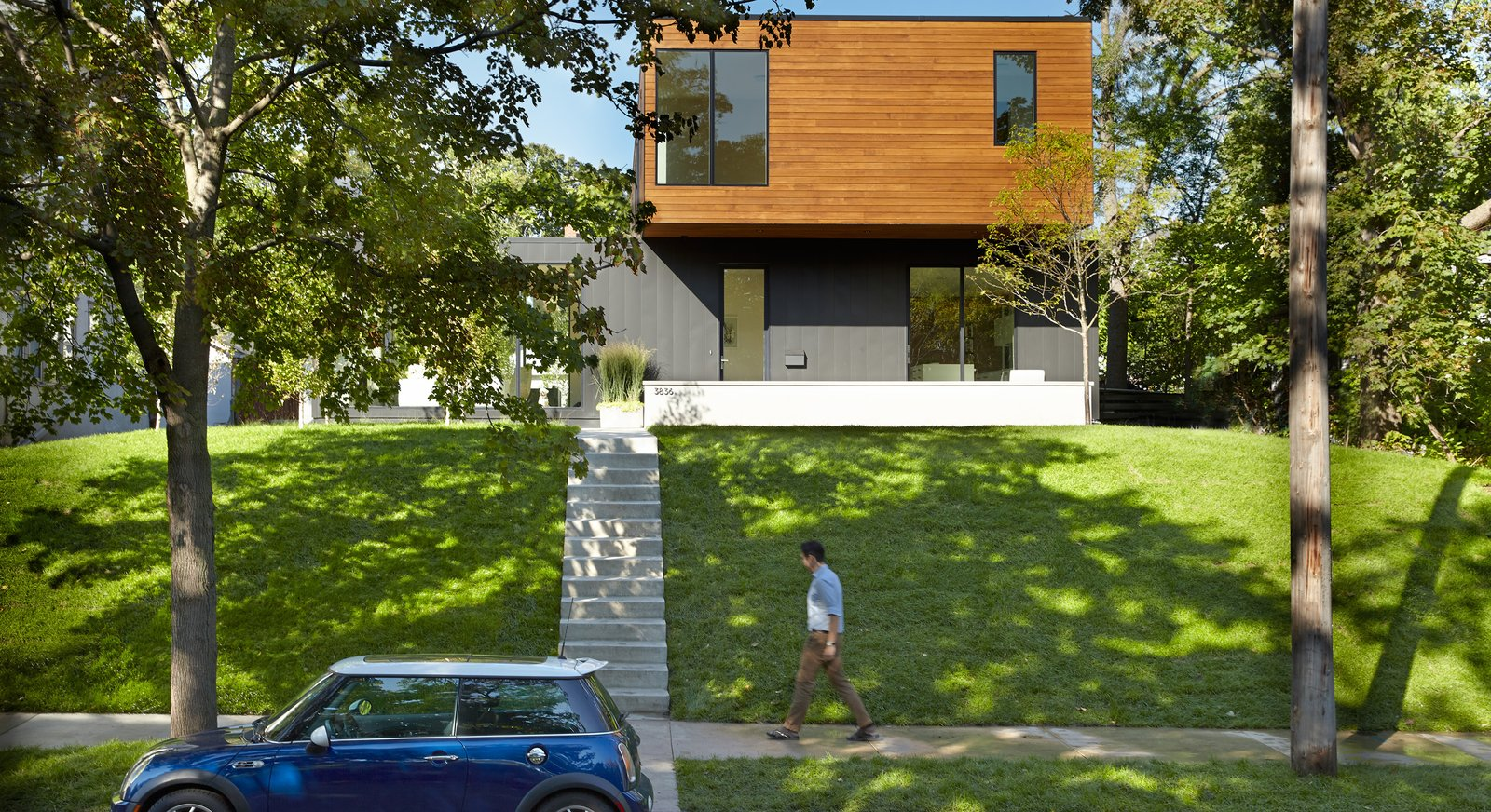 Tagged: Outdoor, Metal Patio, Porch, Deck, Grass, Front Yard, Trees, Concrete Patio, Porch, Deck, and Wood Patio, Porch, Deck.  Sheridan Residence by Peterssen/Keller Architecture