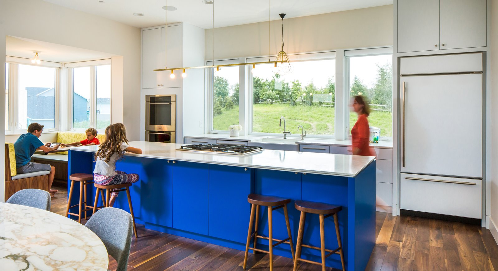 Tagged: Kitchen, Engineered Quartz Counter, White Cabinet, Colorful Cabinet, Medium Hardwood Floor, Accent Lighting, Pendant Lighting, Ceiling Lighting, Wall Oven, Refrigerator, and Cooktops.  Best Photos from Credit River Residence