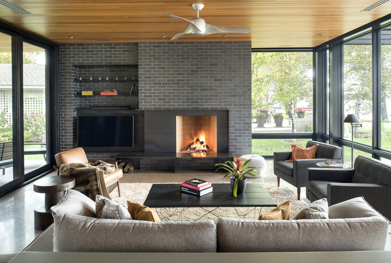 Tagged: Living, Chair, Sofa, Recessed, Concrete, and Wood Burning.  Best Living Wood Burning Recessed Photos from Pelican Lake Modern