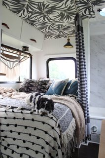 A Portland Couple Renovate a 1982 RV, Turning It Into Their New Home - Photo 12 of 12 - One of their dogs, Cudi, blends in with textiles that overflow on the bed in their RV.