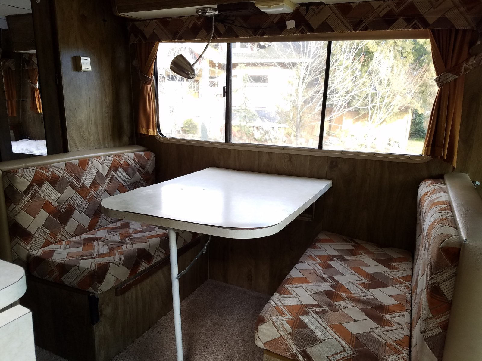 The Winnebago's original dinet area before Kamarul renovated.  Photo 7 of 13 in A Portland Couple Renovate a 1982 RV, Turning It Into Their New Home