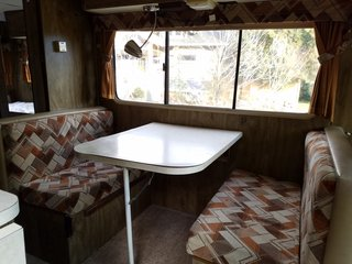 A Portland Couple Renovate a 1982 RV, Turning It Into Their New Home - Photo 6 of 12 - The Winnebago's original dinette area before they renovated it.