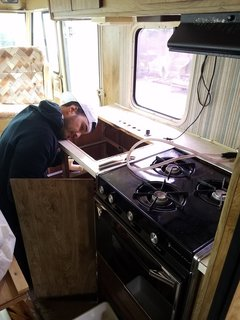 A Portland Couple Renovate a 1982 RV, Turning It Into Their New Home - Photo 5 of 12 - Tim Kamarul working on the RV's plumbing.