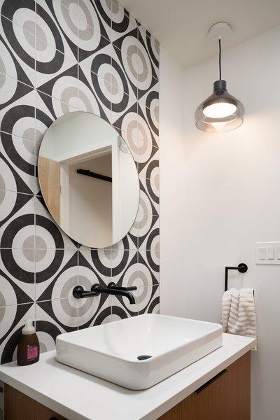 Modern home with bath room, porcelain tile floor, engineered quartz counter, vessel sink, ceramic tile floor, ceramic tile wall, pendant lighting, and porcelain tile wall. Guest Bath Photo 6 of 20th Street