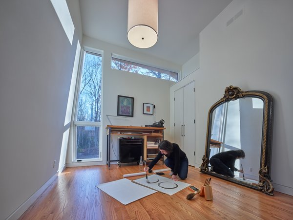 "Modern home with office, study, desk, and medium hardwood floor. Both the client and Charlottesville architect HEDS share a passion for a Zen design approach and the importance of celebrating the ""rituals"" of everyday life.  Photo 9 of Mill Pond House"