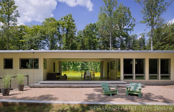 "Modern home with outdoor, trees, back yard, small patio, porch, deck, grass, and concrete patio, porch, deck. The ""dogtrot"" is believed to have originated in the southern Appalachian Mountains. Photo 5 of Dogtrot at Stony Point"