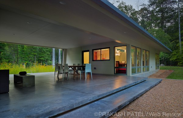 Modern home with outdoor, back yard, small patio, porch, deck, and concrete patio, porch, deck. The concrete terrace provides a cool setting for evening meals and relaxation. Photo 7 of Dogtrot at Stony Point
