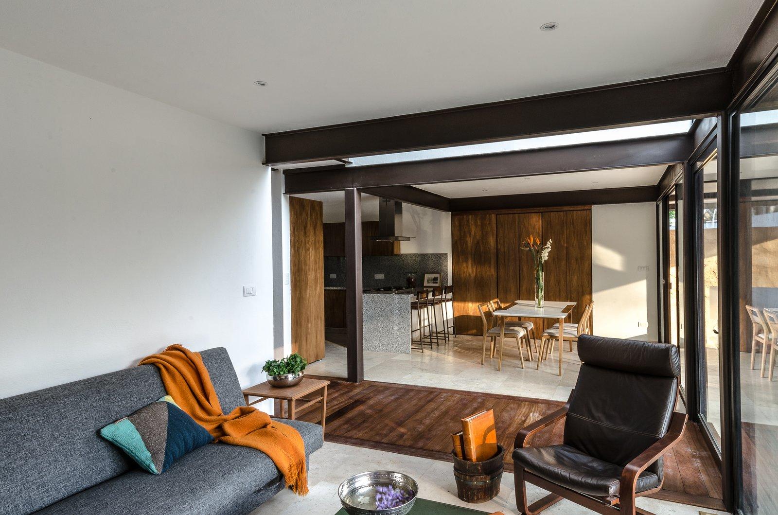 Living room Tagged: Living Room, Travertine Floor, Sofa, Dark Hardwood Floor, Ceiling Lighting, and Recliner.  CQ12 by tescala
