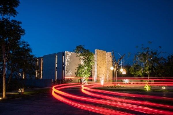 Modern home with outdoor, front yard, and landscape lighting. Facade Photo 19 of Casa Chaaltun