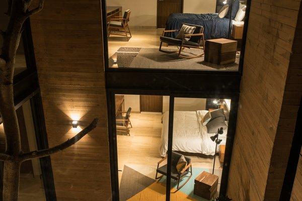 Modern home with bedroom, chair, floor lighting, bed, ceiling lighting, travertine floor, accent lighting, and marble floor. Bedrooms Photo 15 of Casa Chaaltun