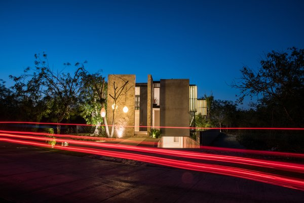 Modern home with outdoor, landscape lighting, trees, hanging lighting, and front yard. Facade Photo 20 of Casa Chaaltun