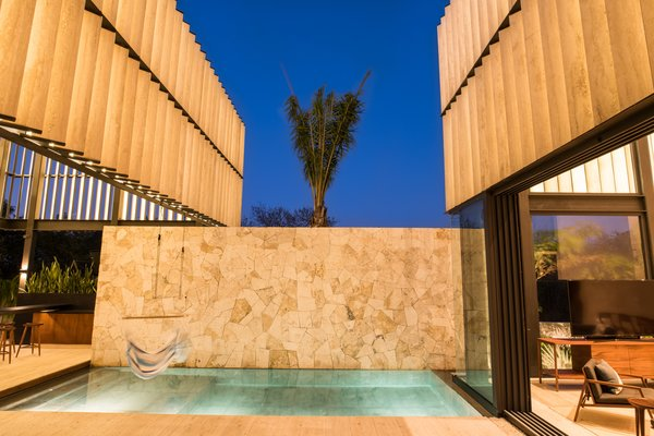 Modern home with outdoor, standard construction pool, and back yard. Pool (cenote) Photo 12 of Casa Chaaltun