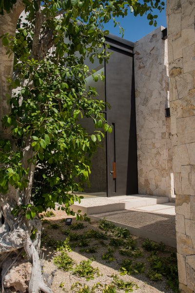Modern home with outdoor, front yard, and trees. Main entrance Photo 16 of Casa Chaaltun