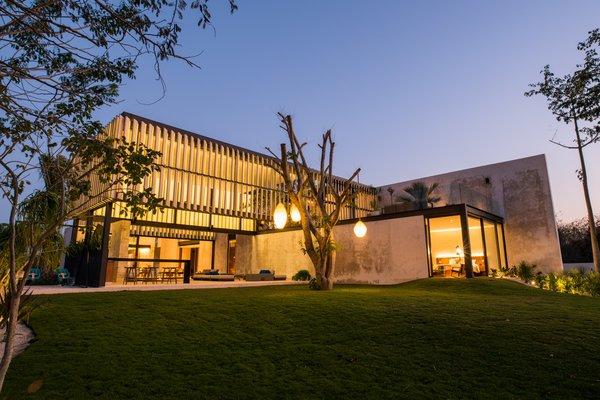 Modern home with outdoor, trees, and garden. Garden facade Photo 10 of Casa Chaaltun