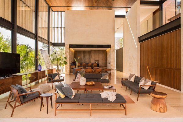 Modern home with living room, sofa, ceiling lighting, wall lighting, console tables, bench, travertine floor, pendant lighting, and marble floor. Living Photo 3 of Casa Chaaltun