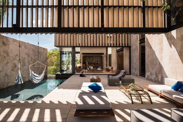 Modern home with outdoor, back yard, stone patio, porch, deck, standard construction pool, and large patio, porch, deck. Terrace Photo  of Casa Chaaltun