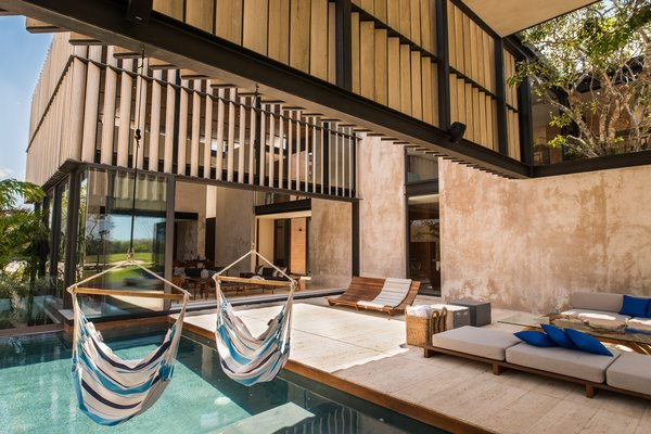 Modern home with outdoor, standard construction pool, and back yard. Pool Photo 7 of Casa Chaaltun