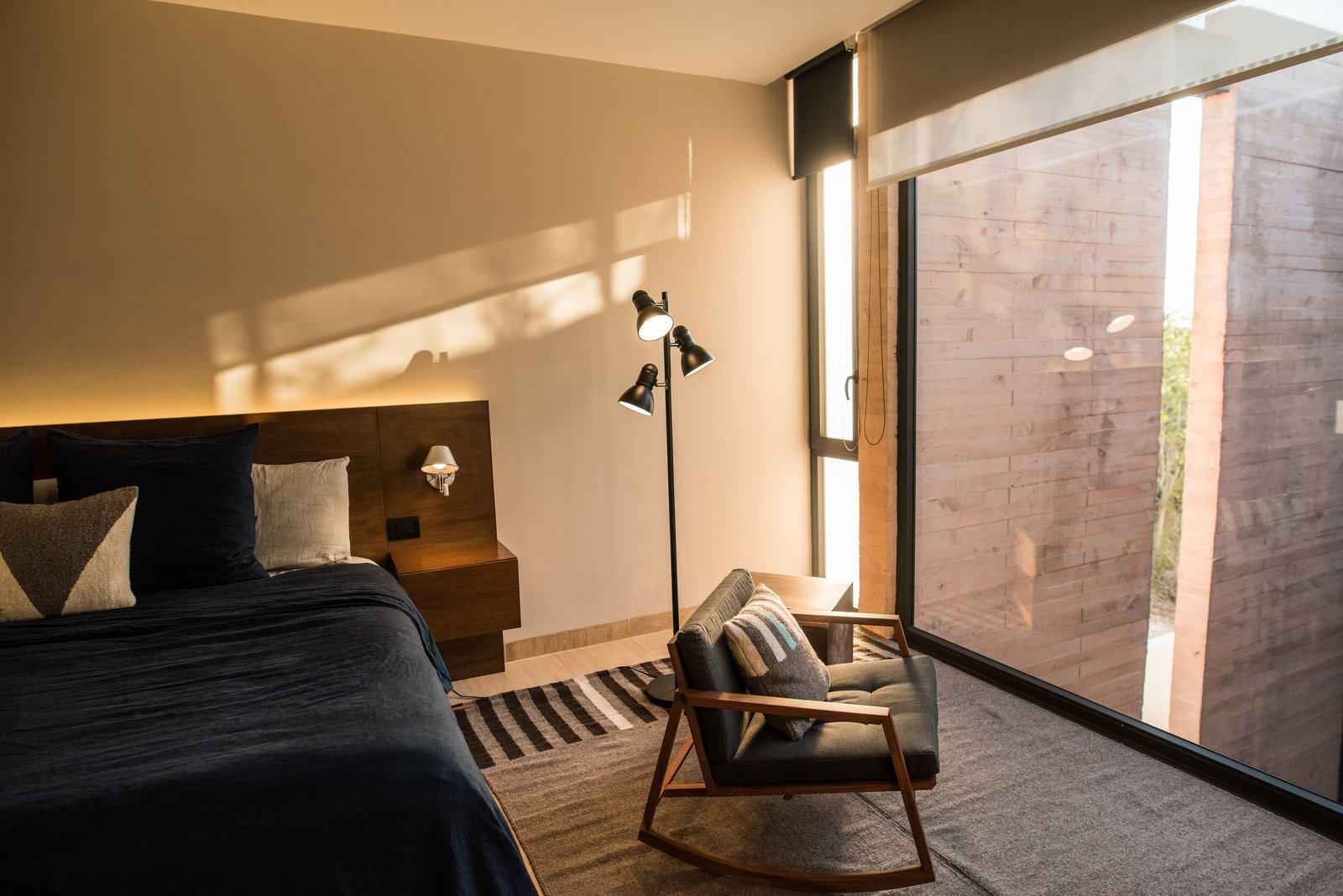 Bedroom Tagged: Bedroom, Chair, Travertine Floor, Accent Lighting, Marble Floor, and Floor Lighting. Casa Chaaltun by tescala