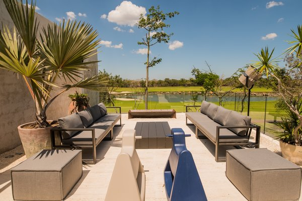 Modern home with outdoor, rooftop, trees, gardens, and large patio, porch, deck. Sunset Terrace Photo 4 of Casa Chaaltun