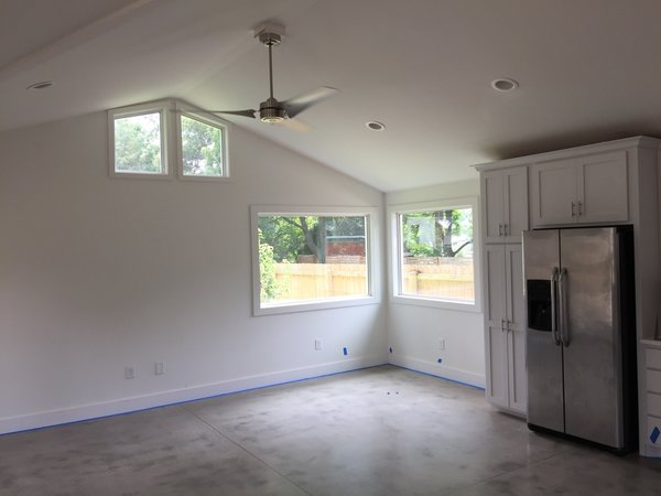 Modern home with dining room, recessed lighting, and concrete floor. Photo 4 of West Side Rental