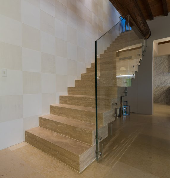 Modern home with staircase, stone tread, and glass railing. Photo 9 of Campo al Doccio