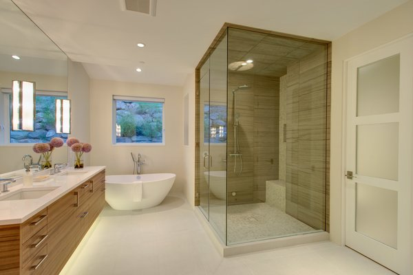 Modern home with bath room, freestanding tub, ceiling lighting, corner shower, and drop in sink. Photo 9 of The Wilds