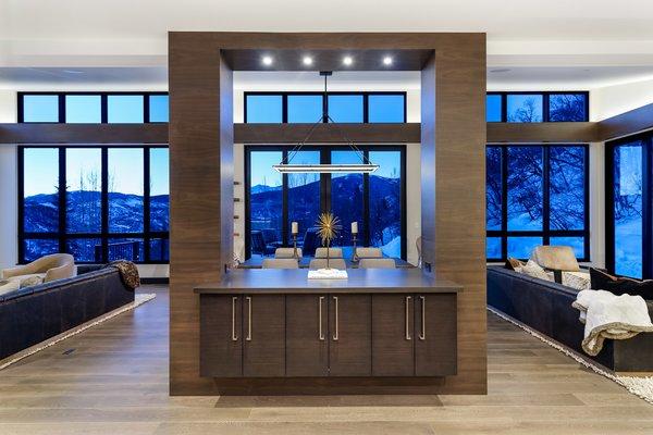 Modern home with recessed lighting, ceiling lighting, living room, bar, and medium hardwood floor. Photo 5 of Saddleback Lane