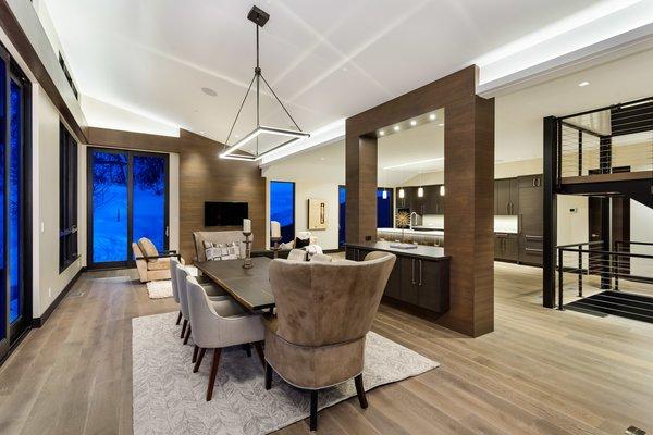 Modern home with dining room, table, chair, bar, pendant lighting, recessed lighting, ceiling lighting, and medium hardwood floor. Photo 6 of Saddleback Lane