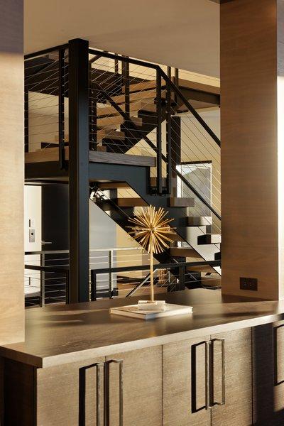 Modern home with bar, staircase, wood tread, and metal railing. Photo 9 of Saddleback Lane