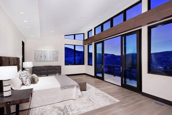 Modern home with bedroom, bed, recessed lighting, and medium hardwood floor. Photo 12 of Saddleback Lane