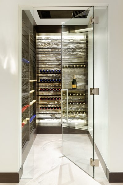 Modern home with wine cooler and storage room. Photo 15 of Saddleback Lane
