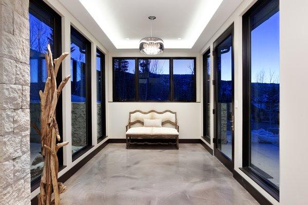 Modern home with hallway and concrete floor. Photo 3 of Saddleback Lane