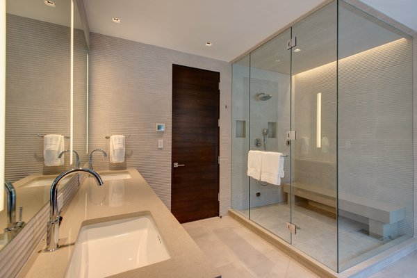 Modern home with bath room, corner shower, undermount sink, recessed lighting, and stone tile wall. Photo 13 of Saddleback Lane